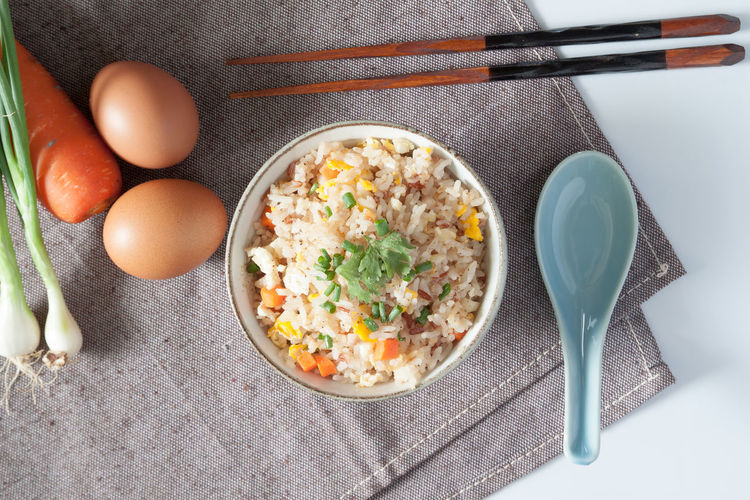 Fried rice with egg and carrot in a bowl Cat Chopsticks Delicious Delicious Food Delivery Delivery Service Egg Egg Yolk Food Freshness Fried Fried Rice Health Healthy Healthy Eating Healthy Food Ingredient Low Carb Diet No People Onion Rice Spooky Vegetable