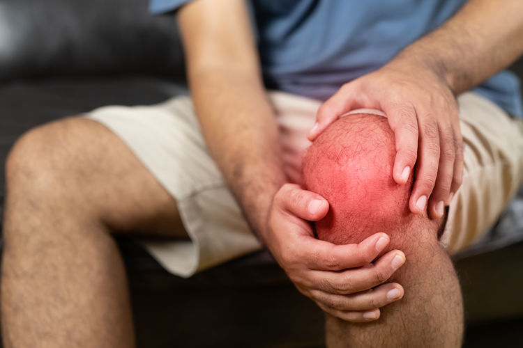 Midsection of man holding apple