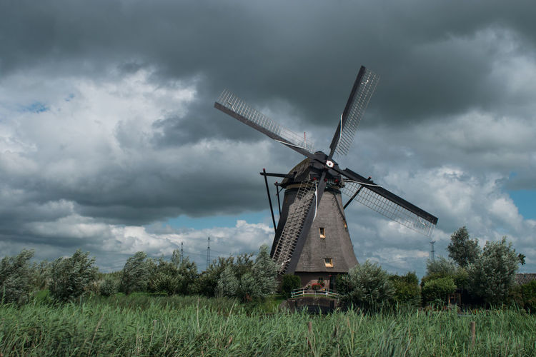 Netherlands Storm Alternative Energy Cloud - Sky Day Dutch Environmental Conservation Field Fuel And Power Generation Grass Industrial Windmill Kinderdijk Nature No People Outdoors Renewable Energy Rural Scene Sky Technology Traditional Windmill Tree Unesco Wind Power Wind Turbine Windmill Your Ticket To Europe