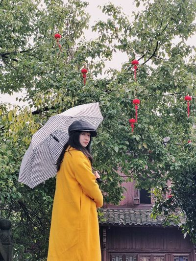 Looking At Camera Raining Umbrella ThatsMe Portrait Chinese New Year Plant One Person Clothing Hat Lifestyles Standing Day Leisure Activity Tree Green Color Outdoors