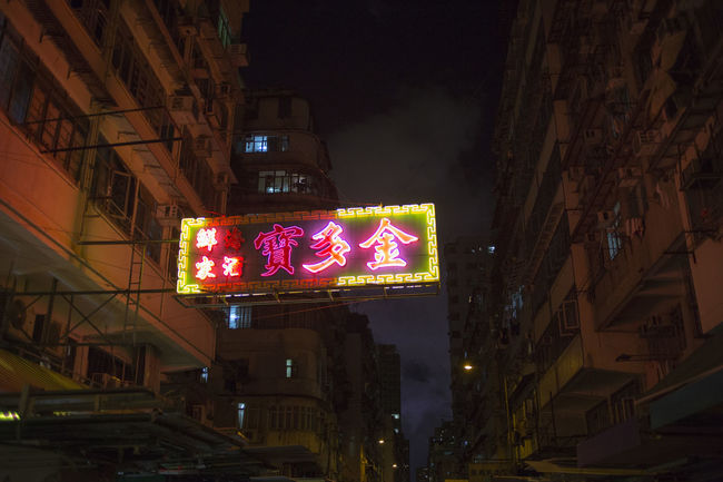Hong Kong HongKong Architecture Building Building Exterior Built Structure City Communication Direction Glowing Illuminated Information Light Lighting Equipment Low Angle View Neon Night No People Outdoors Road Sign Text Western Script