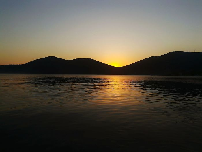 Sunset Nature Mountain Water Outdoors Beauty In Nature No People Landscape Sky Mountain Range Reflection Scenics