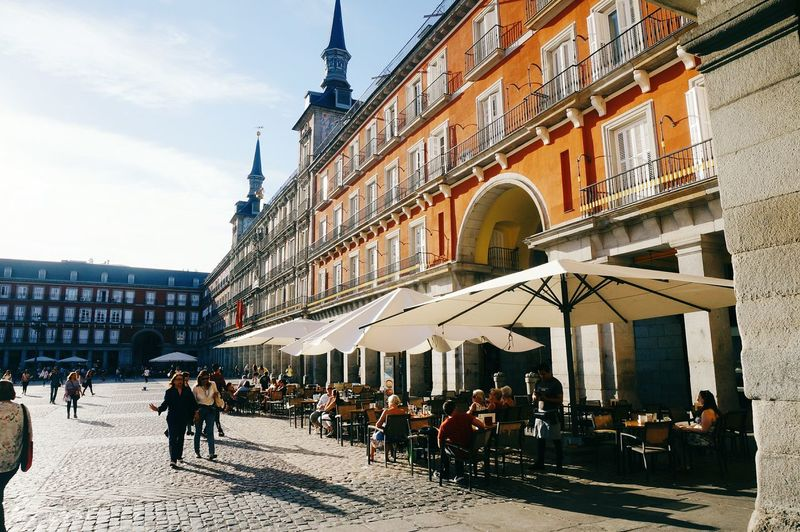 Architecture Travel Destinations Building Exterior Town Square Large Group Of People Vacations Sunlight Day Built Structure People City Outdoors Sky Cityscape Adult Adults Only Street Architecture City Urban City Life Madrid Clean SPAIN