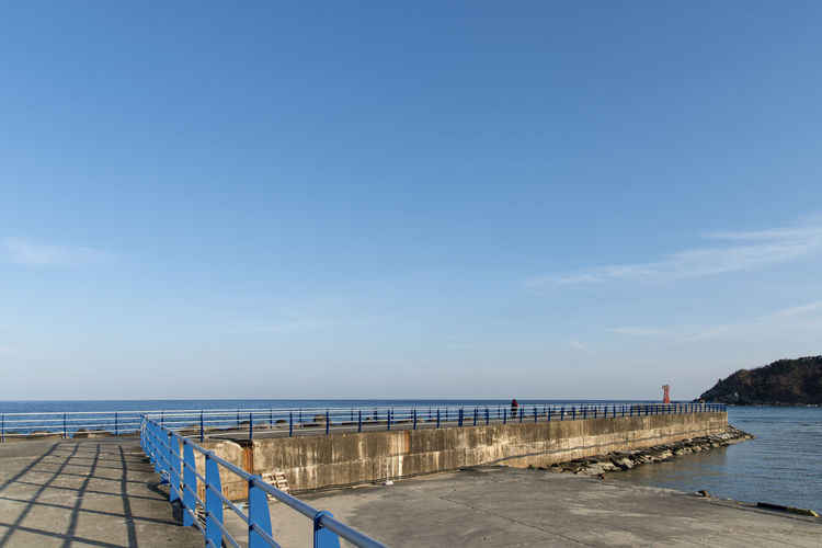 Pier Over Sea Against Blue Sky