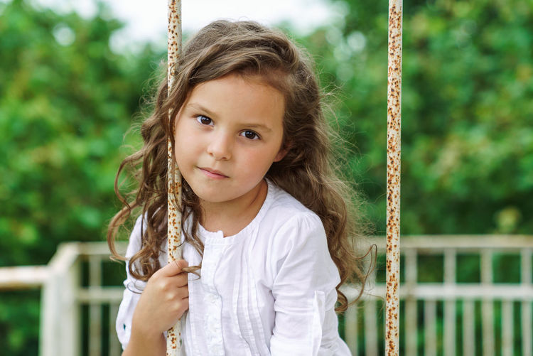 Portrait of cute girl on swing