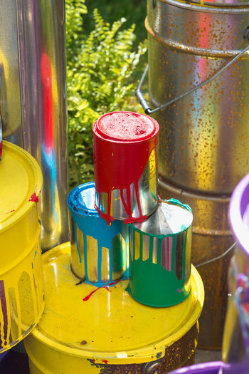 Container Metal No People Close-up Multi Colored Yellow Drink Focus On Foreground Still Life Day Variation Paint Choice Outdoors Cup Household Equipment Food And Drink Refreshment Glass