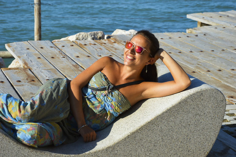 Young woman relaxing on pier