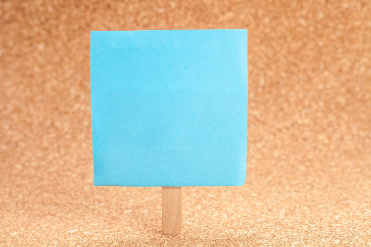 Close-up of blue adhesive note