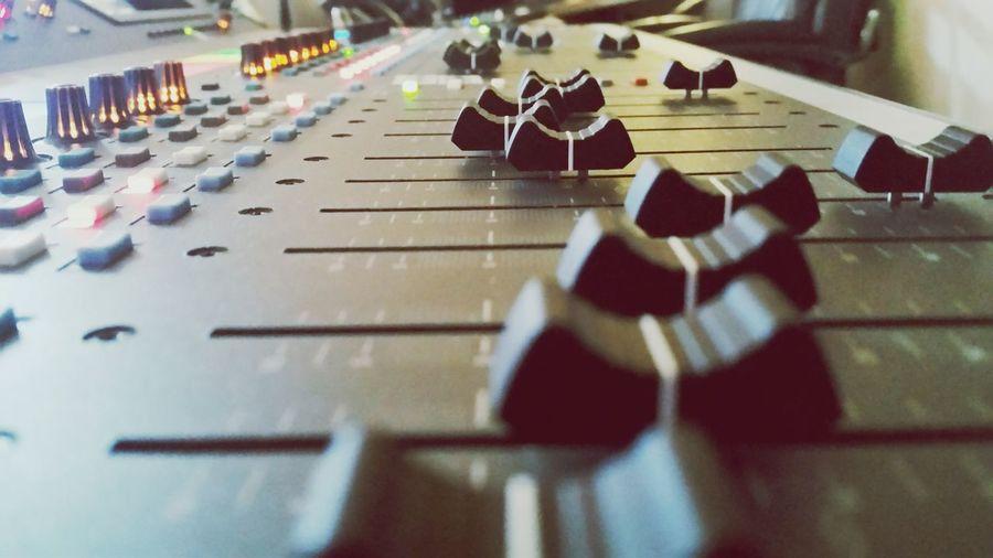 Close-up of sound mixer in studio