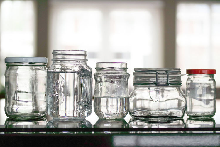 Reusable minimal waste canning jars. Sustainable products. Container Transparent Table Glass - Material Indoors  No People Jar Focus On Foreground Close-up Still Life Group Of Objects Empty Day Glass Variation Selective Focus In A Row Household Equipment Large Group Of Objects Window Purity Mason Jar Masonjar Reusable Recycled Materials Glass Jars Glass Jars On The Table Canning Jars Minimal Waste Waste Reused Materials Reused Sustainable Ecofriendly Water