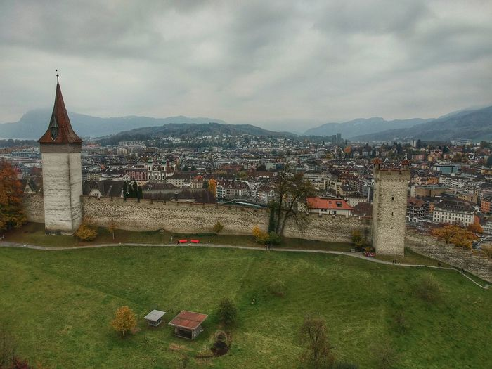Museggmauer overlooking the town - Lucerne, Switzerland 2018 Switzerland Museggmauer Musegg Wall Dronephotography Dji Spark DJI X Eyeem Architecture Building Exterior Built Structure Sky Cloud - Sky City Nature Plant Residential District Travel Destinations Cityscape Outdoors Building No People Day Religion The Past Grass History
