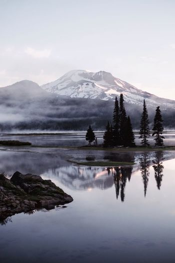 Sparks Lake. First time coming to this beautiful lake. Woke up for a sunrise after memorial weekend to find I had the entire place to myself. Serenity. IG @noeldxng Sparks Lake Lake Oregon Reflection Water Mountain Snow Tree Lake Cold Temperature Reflection Winter Sky Landscape Foggy Tranquil Scene Calm Tranquility Non-urban Scene Idyllic Remote Countryside Snowcapped Mountain Physical Geography Mountain Range Rocky Mountains Scenics Fog Geology The Great Outdoors - 2018 EyeEm Awards A New Beginning Capture Tomorrow