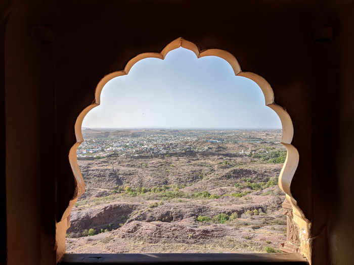 Panoramic view seen through arch window of historic fort of jodhpur