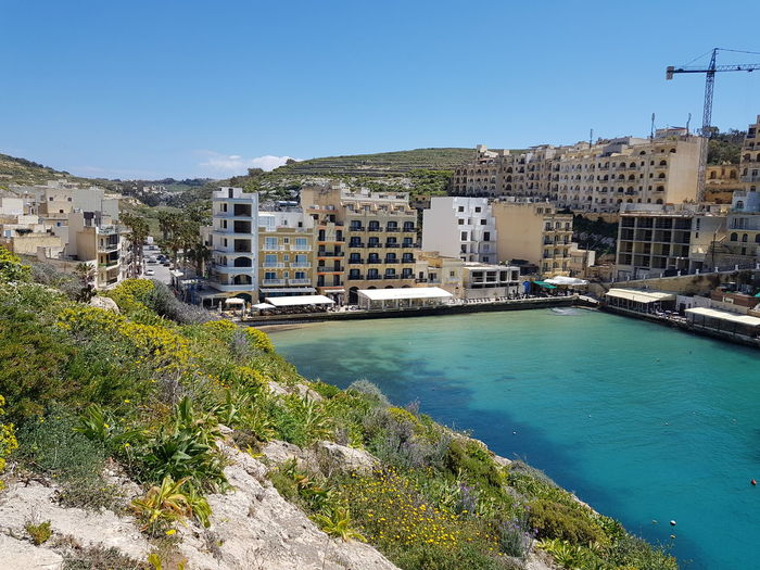 Xlendi, Gozo Xlendi Bay Malta Mediterranean  Holiday No Edit/no Filter Gozo Island Malta Tourquise Sea Water Cityscape Sea Apartment Beach Clear Sky Residential Building City House Sky Turquoise Colored Waterfront Tourist Resort