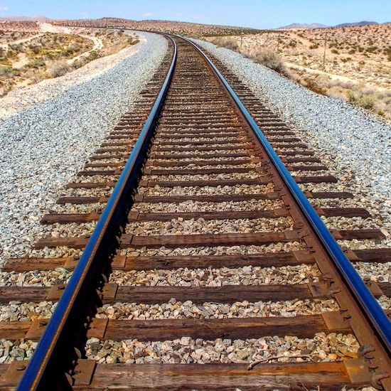 Railroad Track Rail Transportation Transportation Day Outdoors No People Nature Sky EyeEmNewHere Vacation Spot Las Vegas Travel Destinations Desert Sun Transportation Desert Landscape EyeEm Nature Lover Freshness Railroad Track The Way Forward Where Does It Lead? Mountain Range Travel