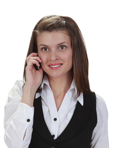 Portrait of a young woman on a phone against a white background. Front View One Person Portrait Young Adult Looking At Camera Smiling Phone Telephone Communication Young Woman Young Woman Smiling Businesswoman Woman Using Phone Woman On The Phone Call Phone Call White Background Isolated Isolated On White Using Phone Technology Studio Shot Mobile Phone Wireless Technology Talking