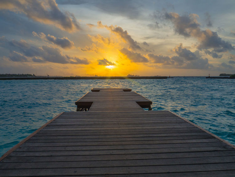 At the airport in Male, Maldives Dockside Beach Photography Dramatic Sky Maldives Ocean View Palm Trees Sand & Sea Sea Scape Tropical Islands Wall Hangings Malecity Maldives Airport Calendar Wallpapers Wall Art Sunset Waterfront Maldives Islands