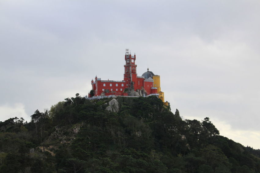 Pena. Business Finance And Industry Castle Cloud - Sky Culture Day Iconic Iconic Buildings Low Angle View Mountain Range Nature No People Outdoors Palace Pena Castle Portugal Sky Tree