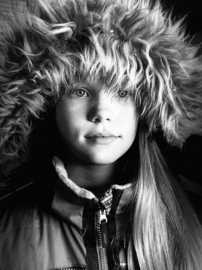 Close-Up Of Girl Wearing Fur Coat