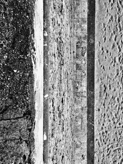 Looking Down at the Beach from a Stone Wall. Lines Textures And Surfaces Black & White