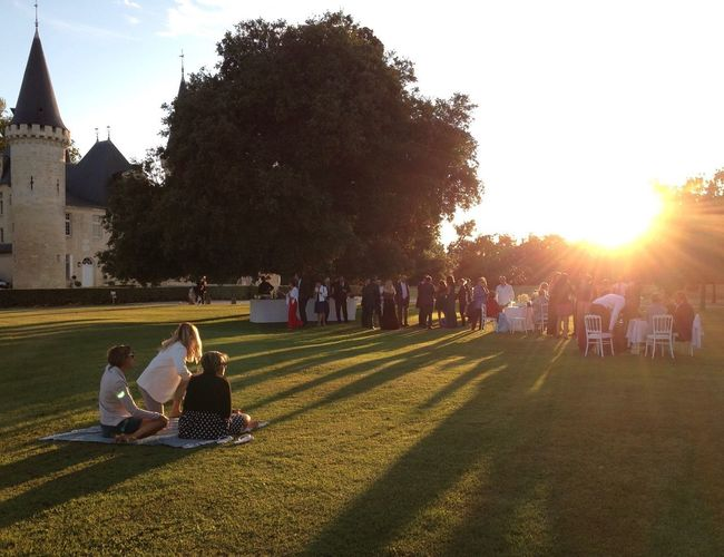 Wedding at French Vineyard Picnic Relaxing Moments Afternoon Summer Atmospheric Mood France Château Lawn Guests Party Wedding Party Wedding Sunlight Togetherness Tree Grass Leisure Activity Lens Flare Large Group Of People Enjoyment Lifestyles Outdoors Shadow Real People Sitting Day