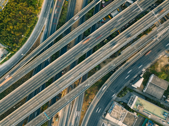 Aerial view of highway and overpass in city Transportation High Angle View Nature City Road Multiple Lane Highway Drone  Crossroad Overpass Car Traffic Aerial View Business Street Travel Cityscape
