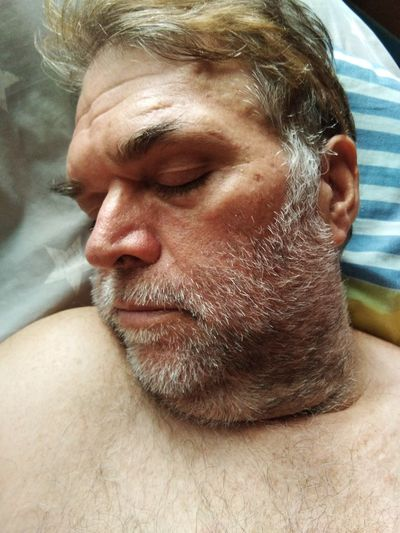 Close-up of mature man sleeping on bed at home