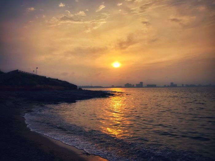 Sunset Sky Water Sea Beauty In Nature Scenics - Nature Beach Cloud - Sky Land Tranquility Tranquil Scene Sun Nature Orange Color Reflection Sunlight Outdoors Horizon No People Idyllic