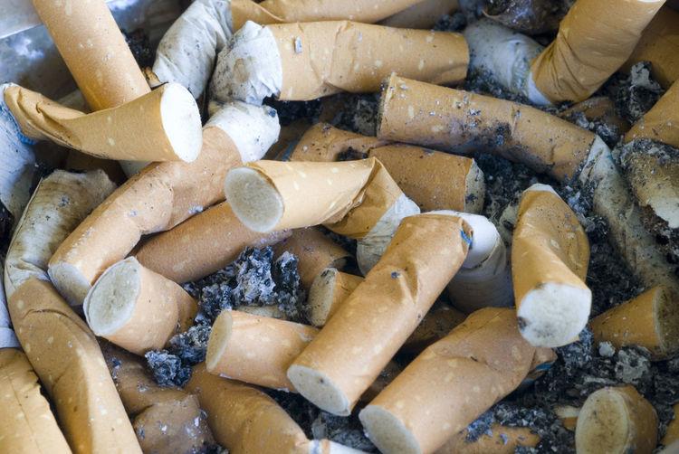 Full Frame Shot Of Burnt Cigarettes