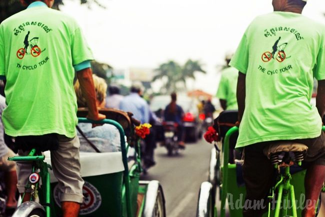 Cyclo Tour around the streets of Phnom Penh, Cambodia ASIA Cambodia Cyclo Green Men People Phnompenh Photography Photooftheday Real People Ride Sightseeing Street Streetphotography Tour Tourism Traffic Travel Travel Photography