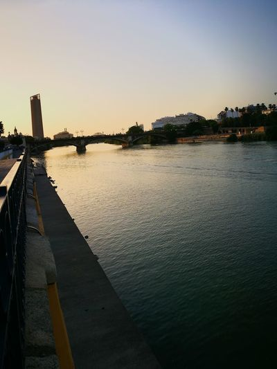 The Street Photographer - 2017 EyeEm Awards Bridge - Man Made Structure Trianeando Art Photography En Triana Triana Bridge Al Caer La Tarde Triana Sevilla Spain Sevilla River Guadalquivir History España 🌞 Tourism Tranquility Travel Destinations Live For The Story City Tower Spain, Andalucia España🇪🇸 Illuminated