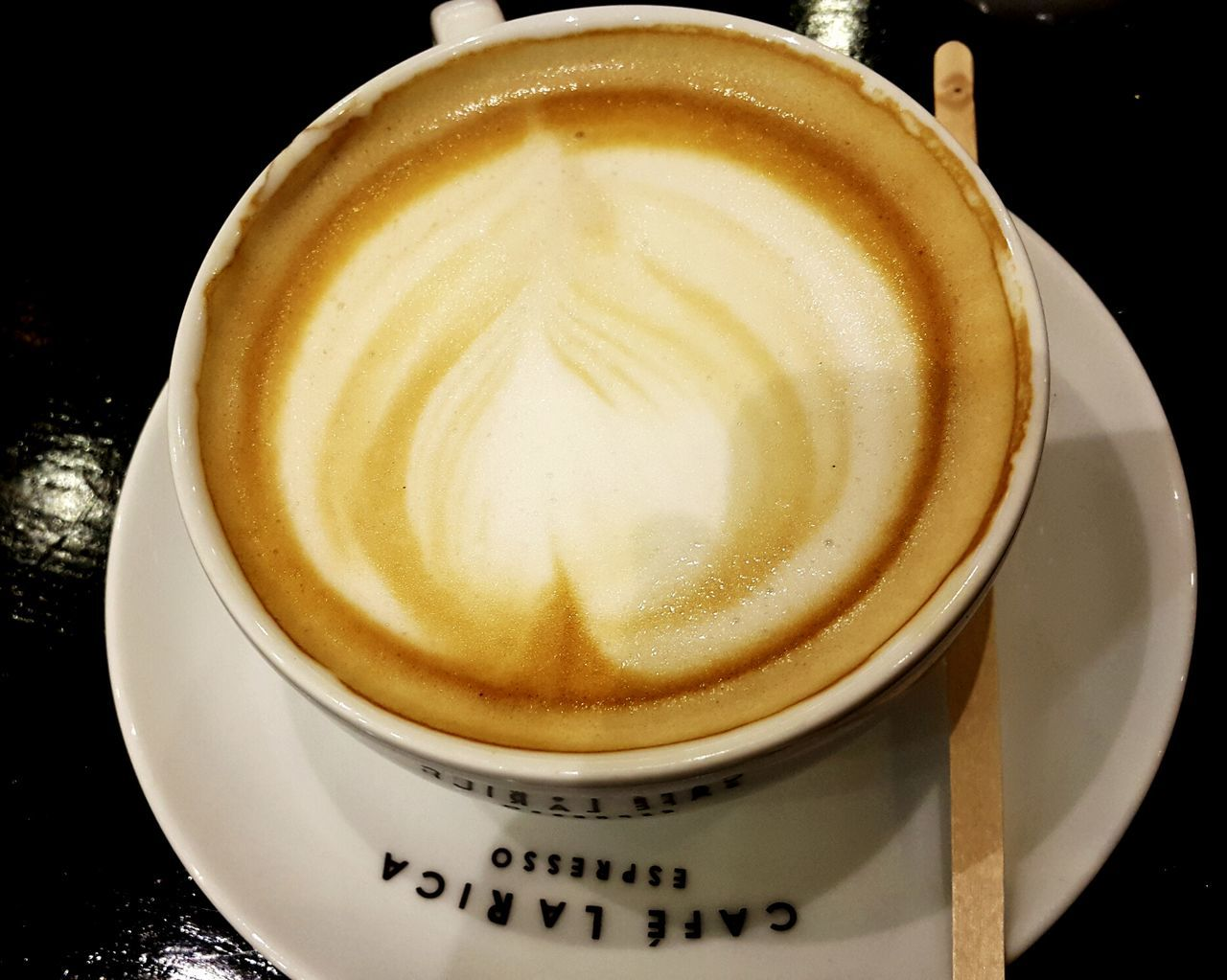 coffee cup, drink, refreshment, frothy drink, coffee - drink, food and drink, cappuccino, froth art, close-up, table, saucer, freshness, high angle view, no people, indoors, latte, healthy eating, day, ready-to-eat