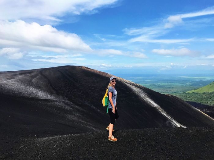 Sky Nature Looking At Camera Adventure Scenics Standing Energetic Volcano Volcano Landscape Hiking Cerro Negro Nicaragua Exploration Volcanic Rock Volcanic Crater Adrenaline Junkie Lava Field Lava Rocks Power In Nature Only Women Hiking Trail Volcano Crater Extreme Sports Exercising