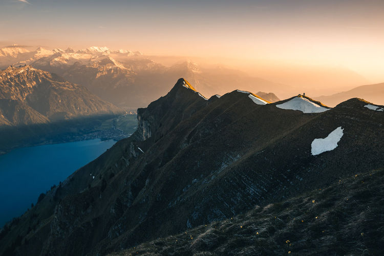 Camping on the Ridge. Augstmatthorn Beauty In Nature Brienzersee Camping Cold Temperature Day Interlaken Lake Landscape Mountain Mountain Range Nature Outdoors Physical Geography Ridge Scenics Sky Snow Sunset Switzerland Tent Tranquil Scene Tranquility Travel Destinations Winter
