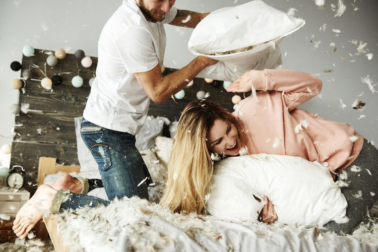 Bed Couple Feathers Fun Laughing Man Pillow Woman Bedroom Enjoying Life Goffin Around Good Times Home Interior Loving Couple Pillowfight Playing Smiling