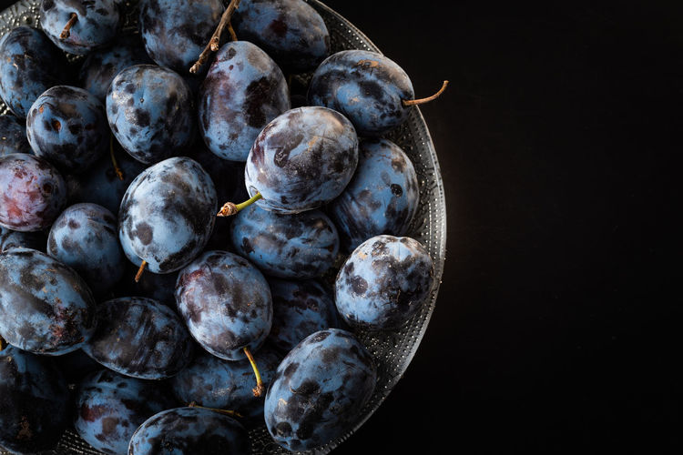 High angle view of blueberries in bowl