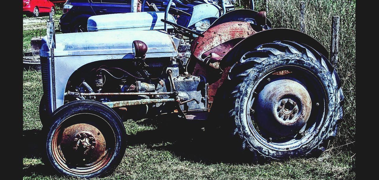 transportation, land vehicle, mode of transport, day, outdoors, wheel, stationary, no people, tire, motorcycle, close-up