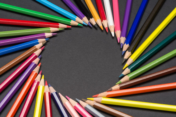 Circular frame made of colored pencil tips, isolated on black cardboard Black Background Circle Creativity Formation Imagination Preschool Arrangement Circular Colored Pencil Colorful Craft Crayon Draw Education Frame Hobby Inspiration Multi Colored Order Pattern Pencil School Spectrum Variation Vibrant