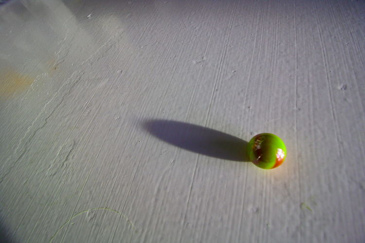 Rolling on!!! Food And Drink Fruit Sports Equipment Healthy Eating Sphere Close-up Sport Table Indoors  Ball Still Life Green Color Single Object Day High Angle View Sunlight Shadow No People Nature Indoors  Wood - Material Flooring
