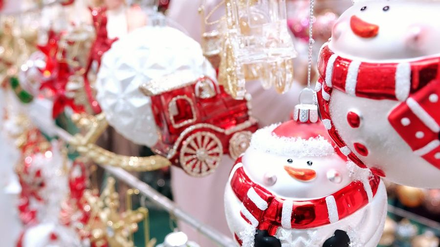 Close-up of christmas decoration hanging at market stall