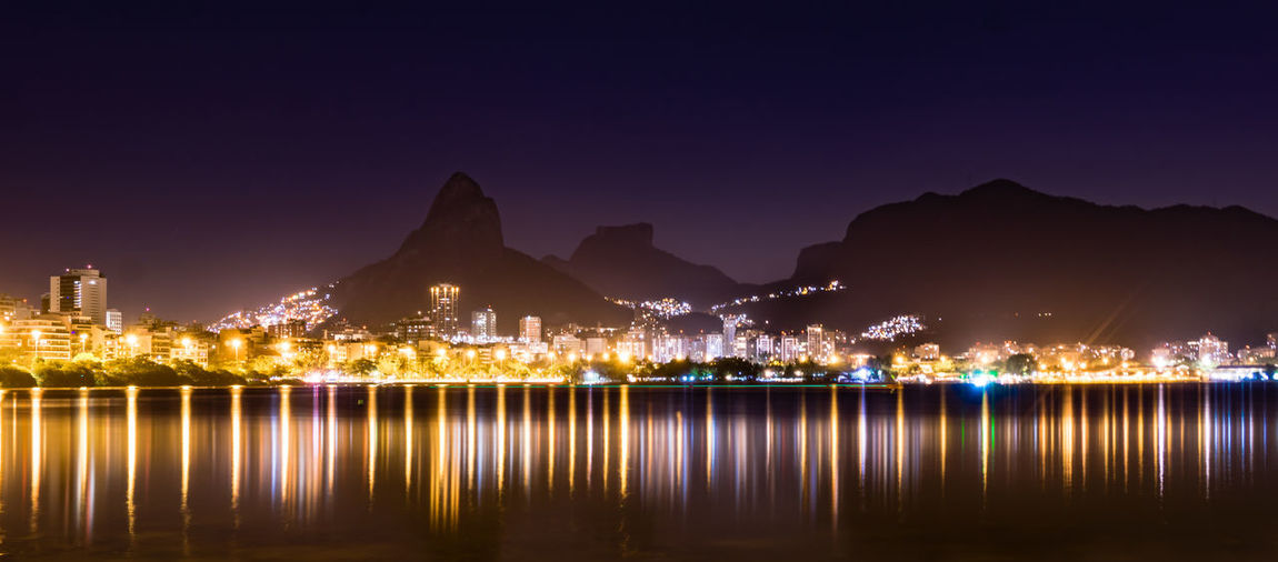 Architecture City Cityscape Illuminated Moon Mountain Night No People Outdoors Reflection Sky Travel Travel Destinations Water