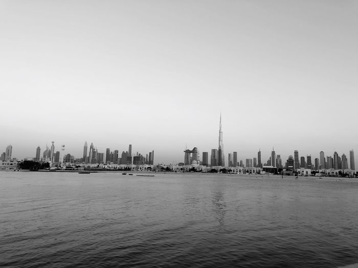DUBAI skyline 🇦🇪 Water Sky Building Exterior Architecture Built Structure City Copy Space Waterfront Clear Sky Office Building Exterior Skyscraper Building Sea Urban Skyline No People Travel Destinations Tall - High Cityscape Modern