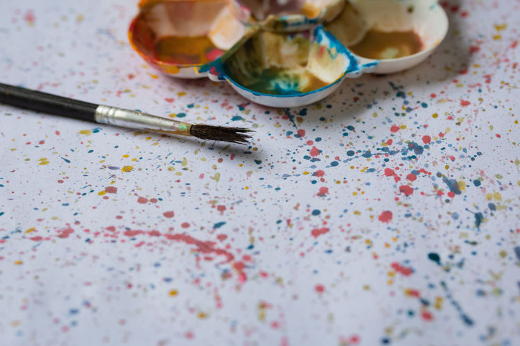 Art And Craft ArtWork Artist Learning Paint Art Arts Culture And Entertainment Celebration Choice Colorful Education Educational Event High Angle View Messy Multi Colored No People Paintbrush Painting Palette School Selective Focus Splash Still Life Table