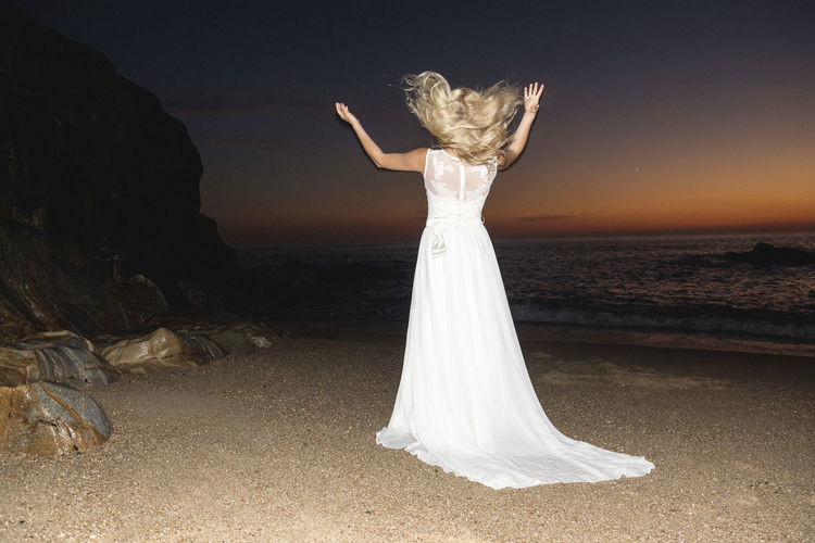 Sirenes Suset Evening Seaside Coast Shore Romantic View Wedding Dress Bride Blonde Girl Sandy Beach Ocean Rocks Linas Was Here International Women's Day 2019