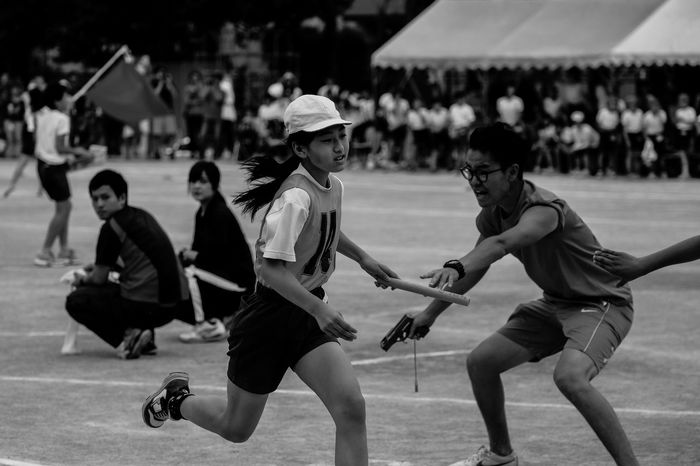 The sports day of elementary school. Competition Elementary School Enjoyment Focus On Foreground Fujifilm Fujifilm X-pro2 Fujifilm_xseries Full Length Fun Sports Day  Lifestyles Motion Performance Playing Relay Relay Race Running Selective Focus Sport The Journalist Eyem 2016 Awards The Portraitist - 2016 EyeEm Awards XF50-140mm