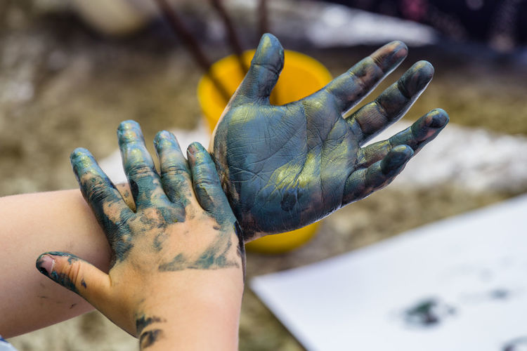 Cropped Image Of Hands Covered With Colors