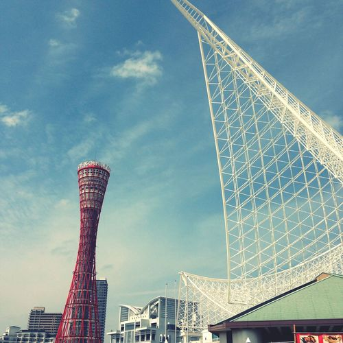 Low Angle View Of Kobe Port Tower And Metal Structure Against Sky