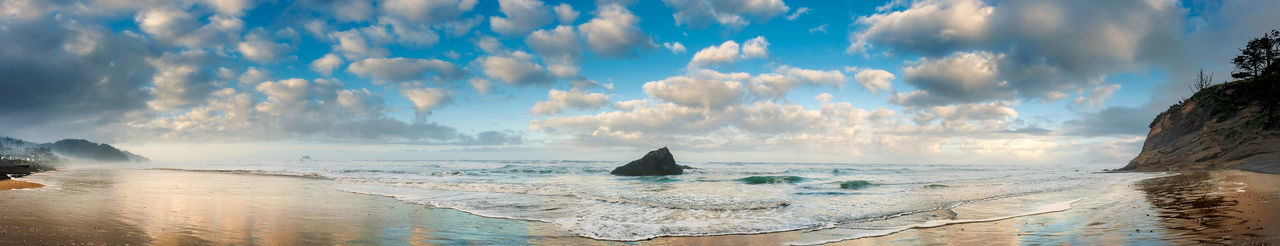Castle Rock, Arch Cape, Oregon. Morning on the beach treated to a wonderful sky and puffy clouds. Water Sky Cloud - Sky Panoramic Sea Nature Scenics - Nature Beach Travel Destinations Beauty In Nature No People Tranquility Day Travel Environment Horizon Outdoors Horizon Over Water Oregon Arch Cape, OR Panorama Castle Rock Pacific Northwest  Sand Rocks