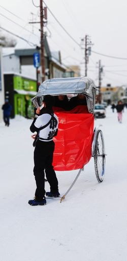 Trishaw Transportation Transport Old-fashioned Warm Clothing Headwear City Snow Full Length Cold Temperature Winter Sport Sports Helmet Snowboarding Snowing Land Vehicle Parking Mode Of Transport Stationary