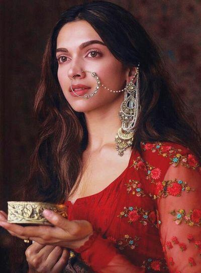 Indian godess Millionnaire Portrait Beautiful Woman Beauty Luxury Young Women Red Wealth Precious Gem Studio Shot